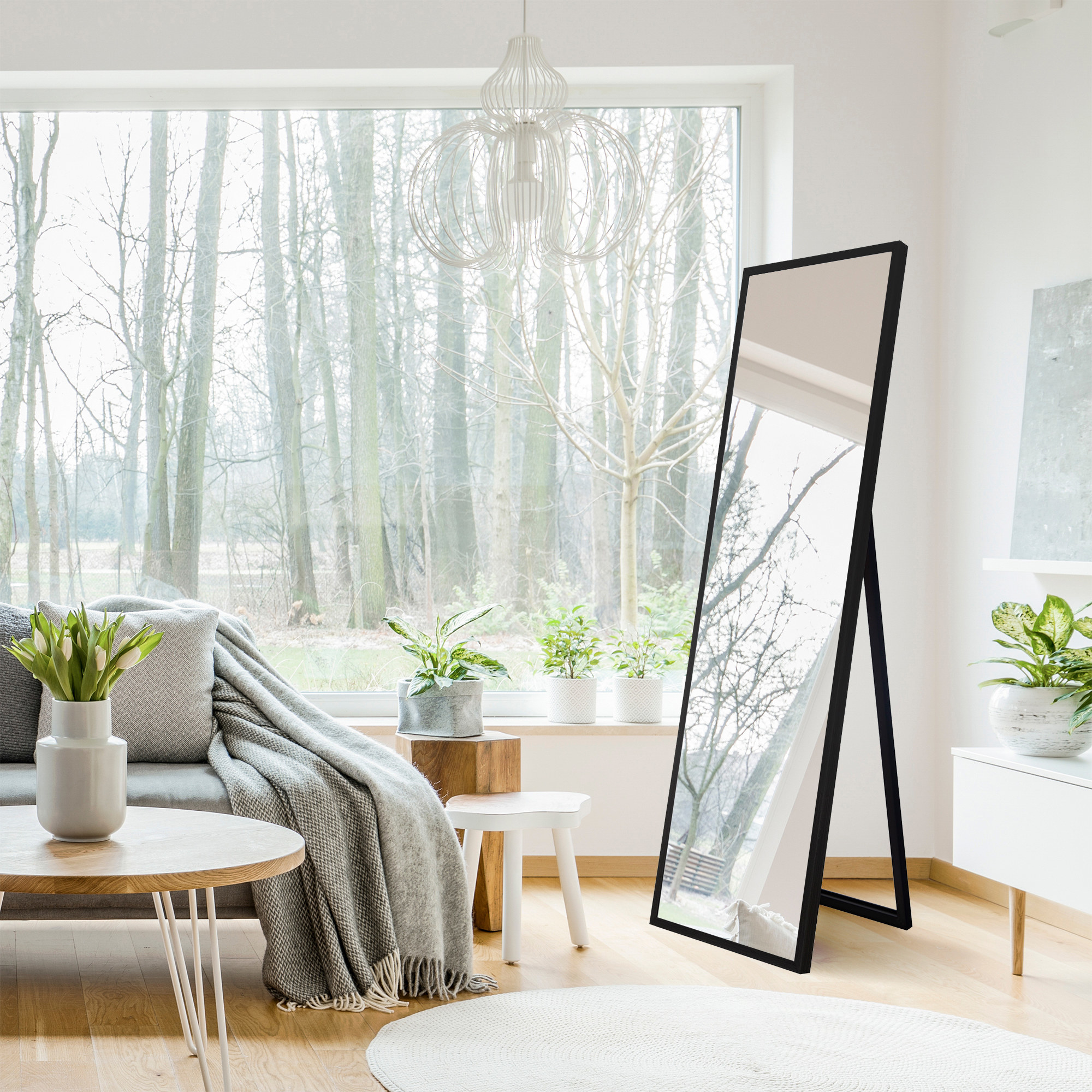 A full length easel mirror with black edges