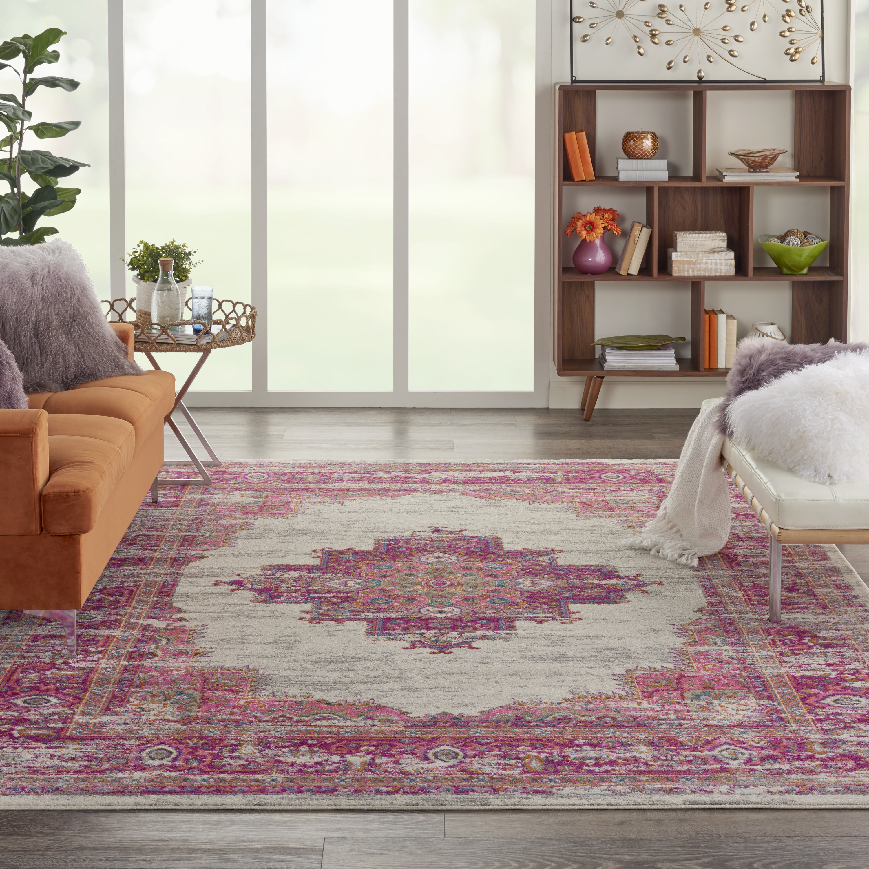 pink area rug sitting in a living room