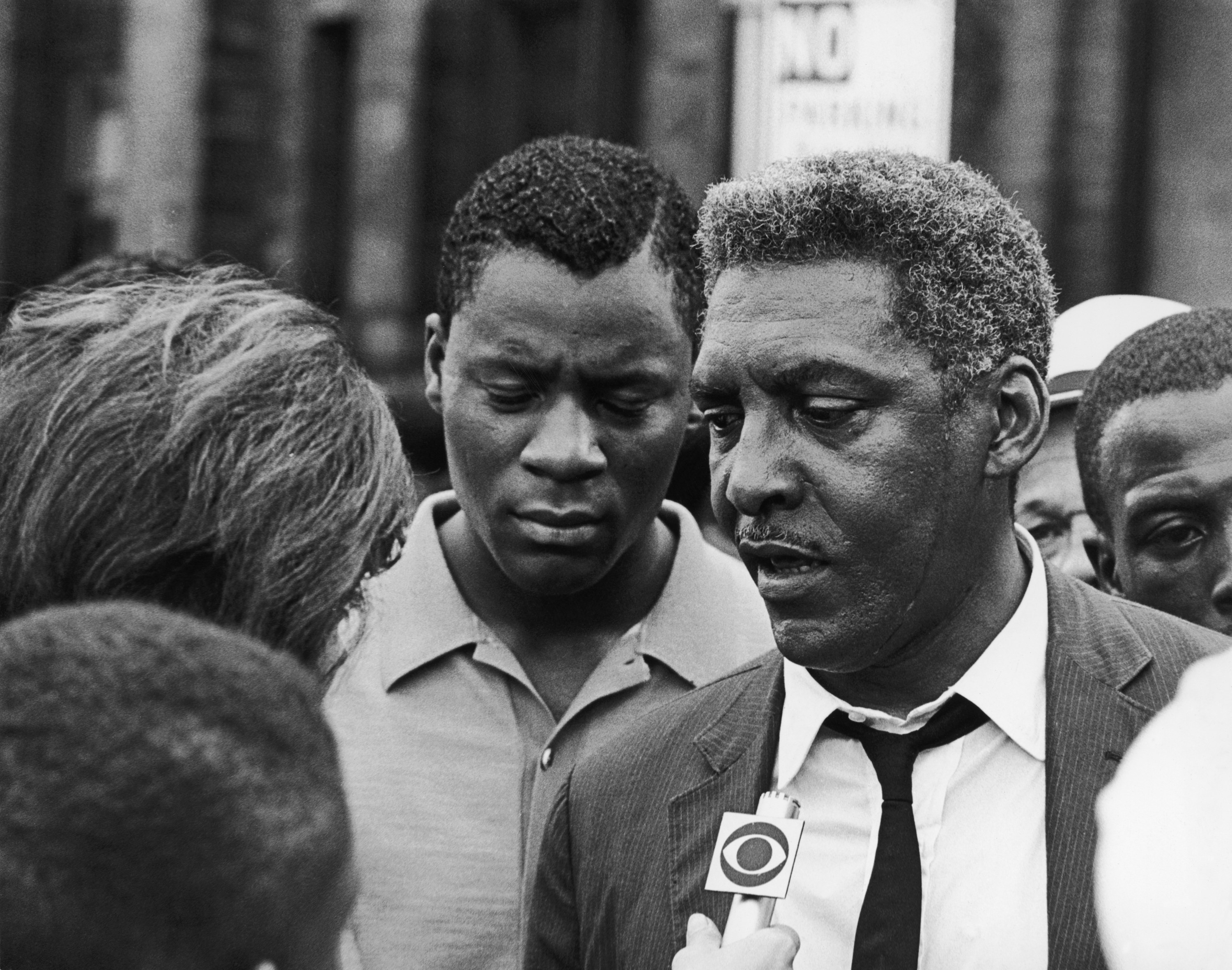 African-American civil rights activist Bayard Rustin (1912 - 1987) talks to a reporter during the Harlem Riots in Manhattan, 23rd July 1964.
