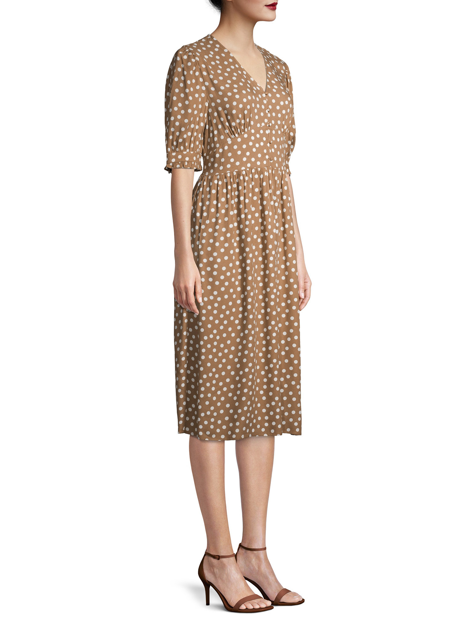 a model in the tan dress with white polka dots