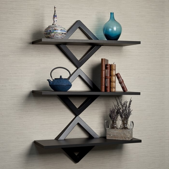 The modern wall shelf from Latitude Run hung on a wall