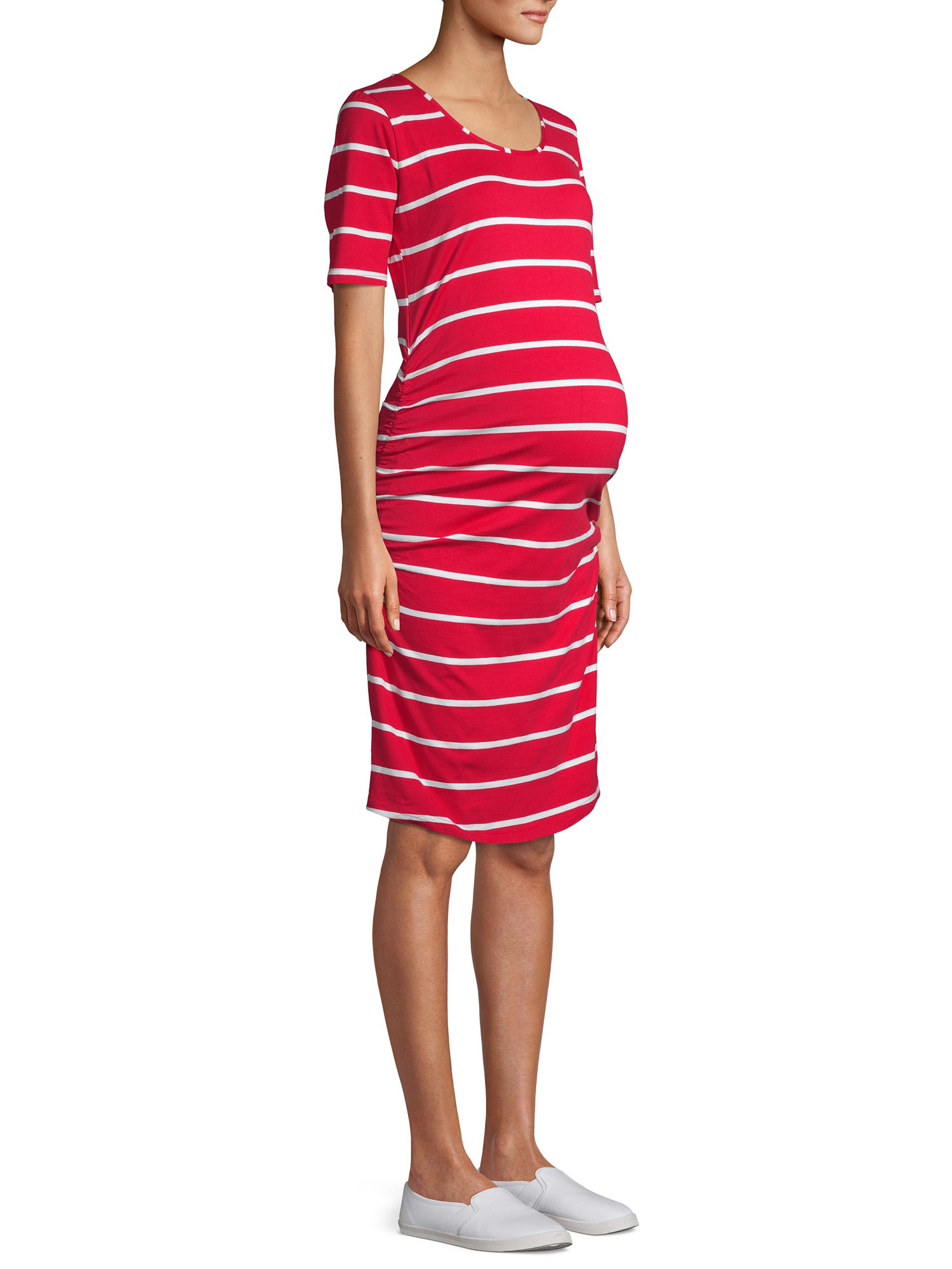 a model in a red dress with vertical white stripes