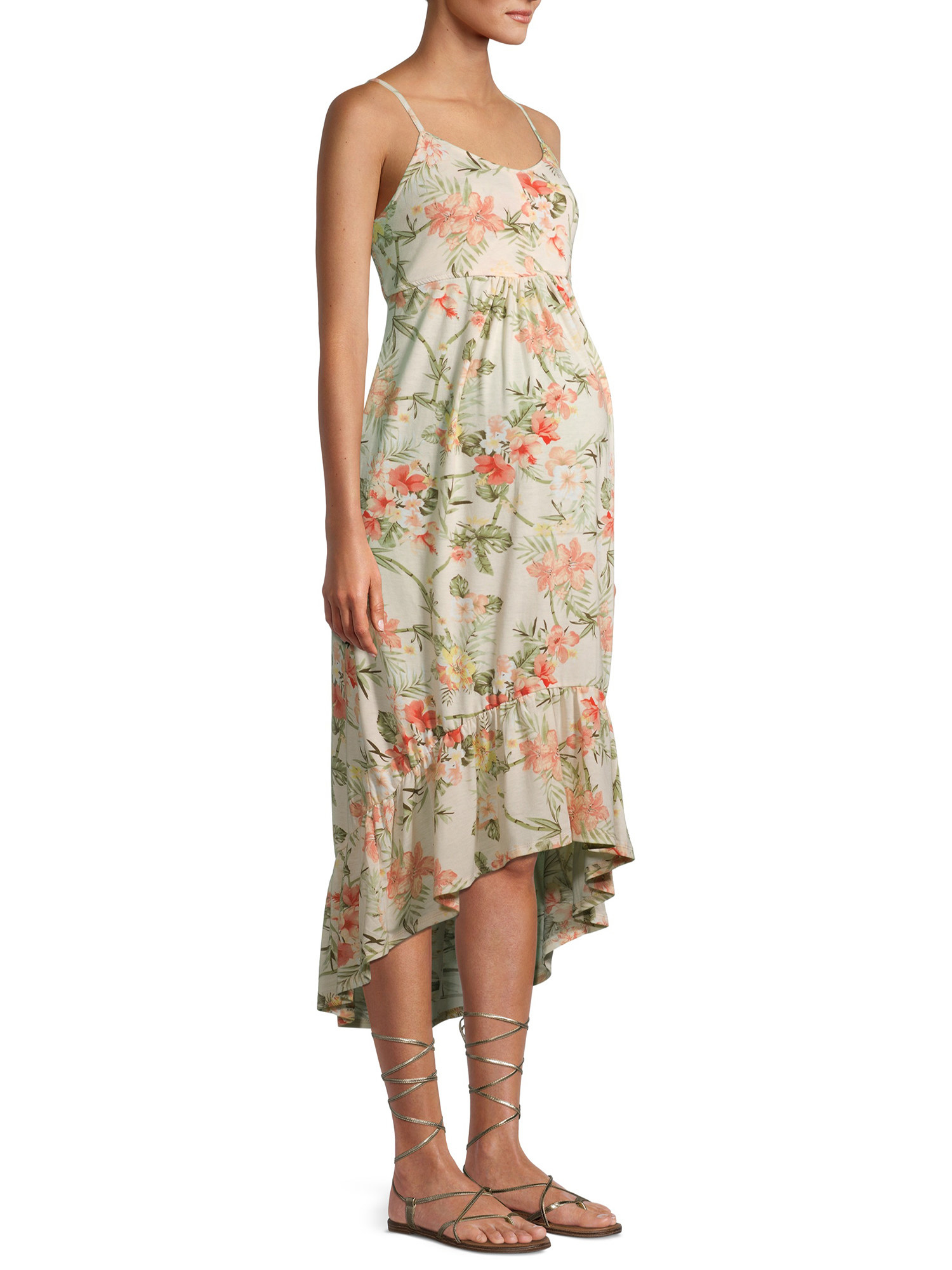 a model in a high low dress with a pink and green floral print