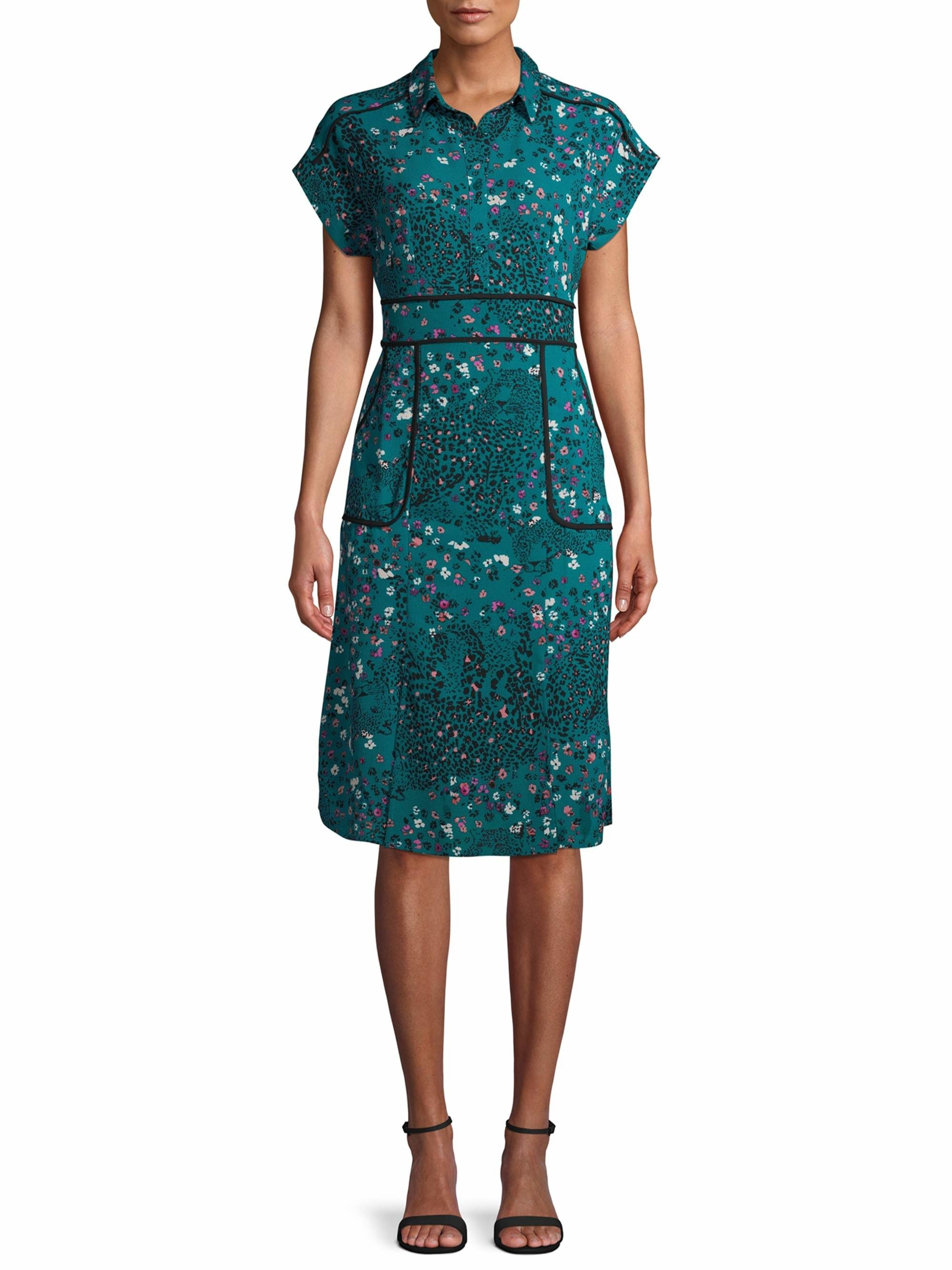 a model in a fitted teal green dress with a collar and floral print