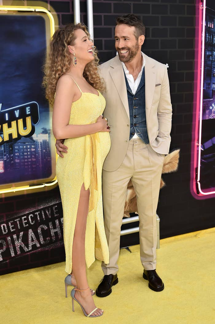 Blake Lively (left) and Ryan Reynolds (right), laughing in this photo from the premiere of the movie Detective Pikachu