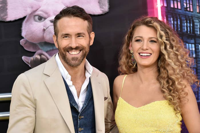Ryan Reynolds (left) and Blake Lively (right) smiling widely at a movie premiere