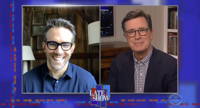 Two men, Ryan Reynolds (left) and Stephen Colbert (right) smile in adjacent panels during an interview on a late-night talk show