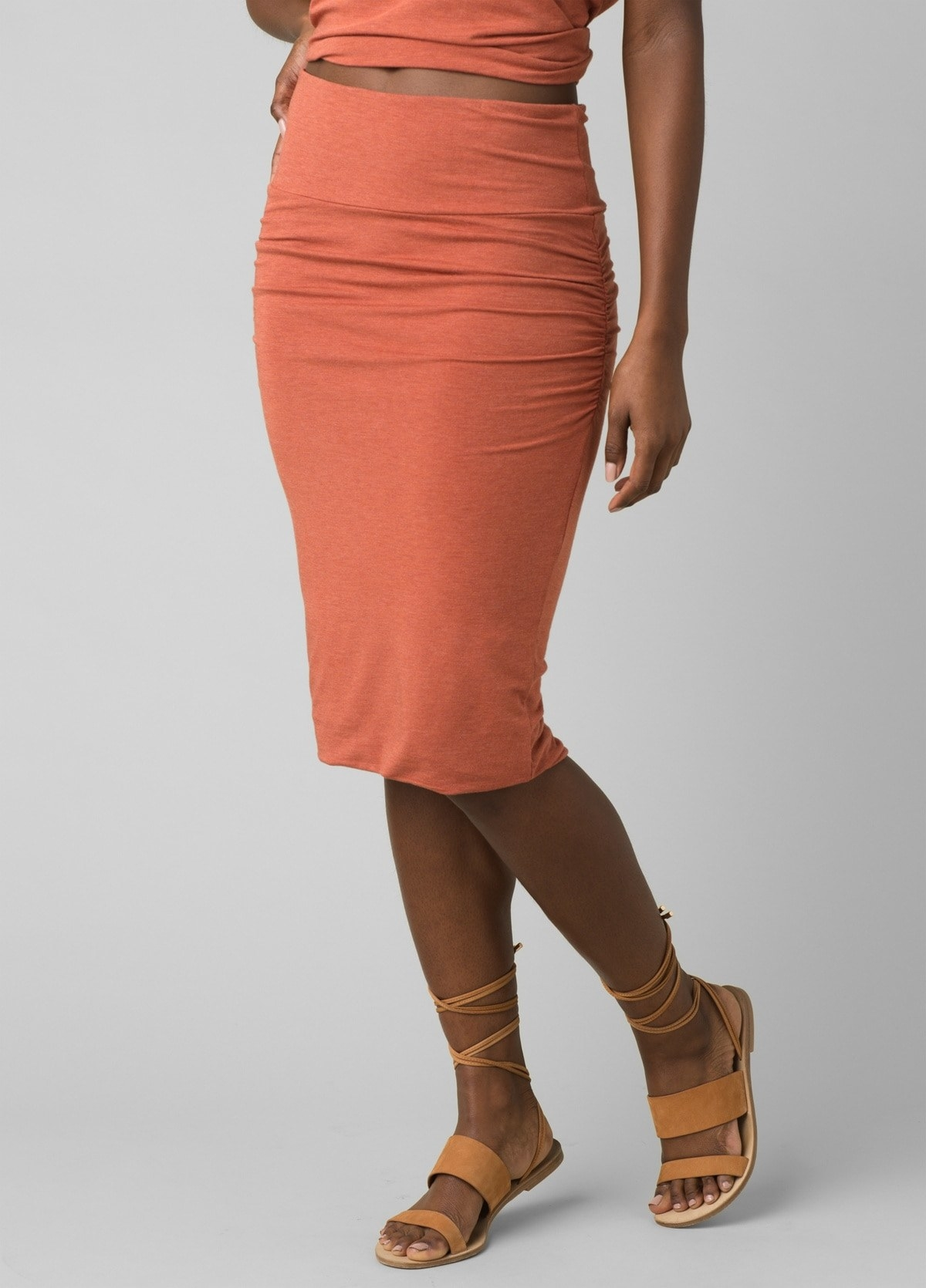 model in tight orange skirt that goes just past the knees