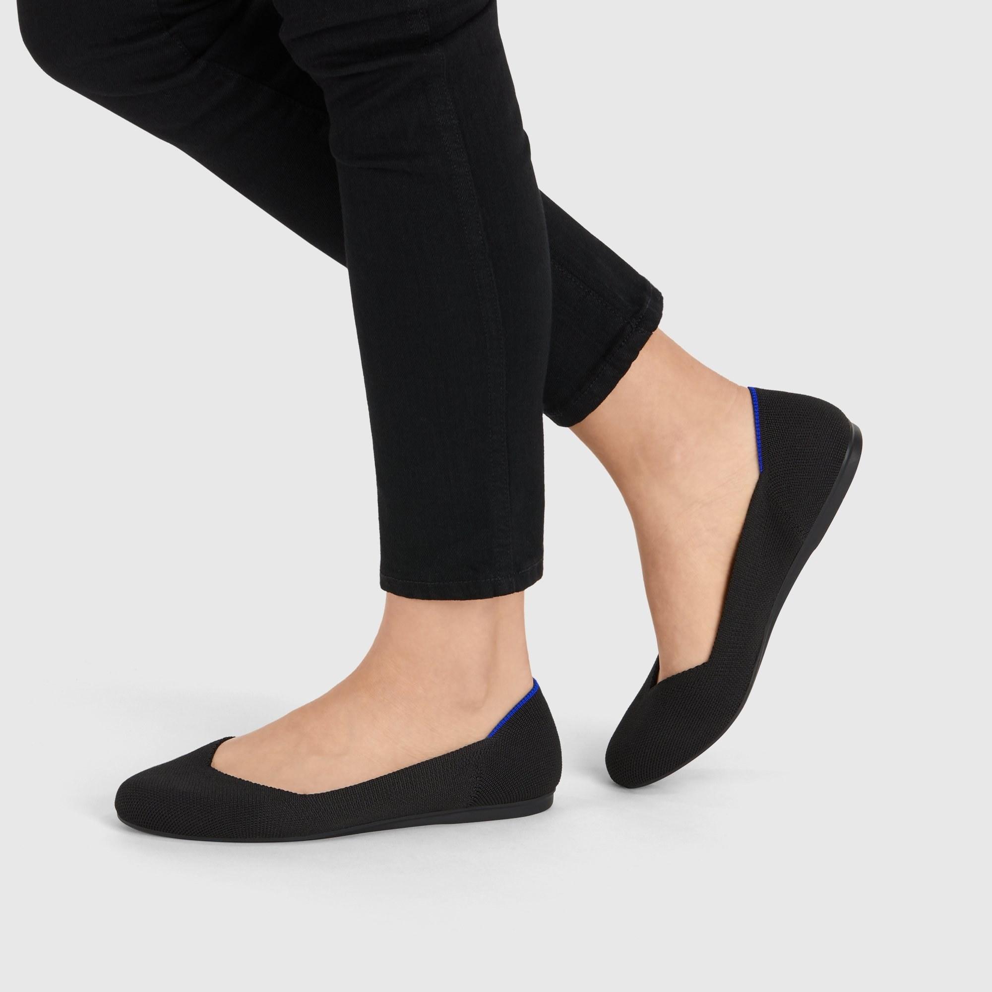 Model wearing the knit flat in black