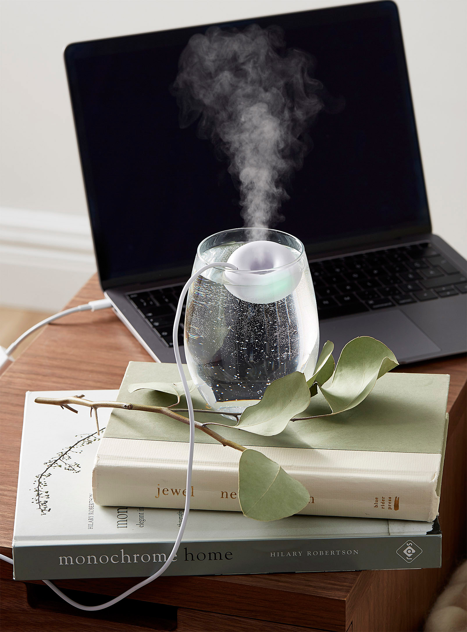 A floating humidifier in a glass of water