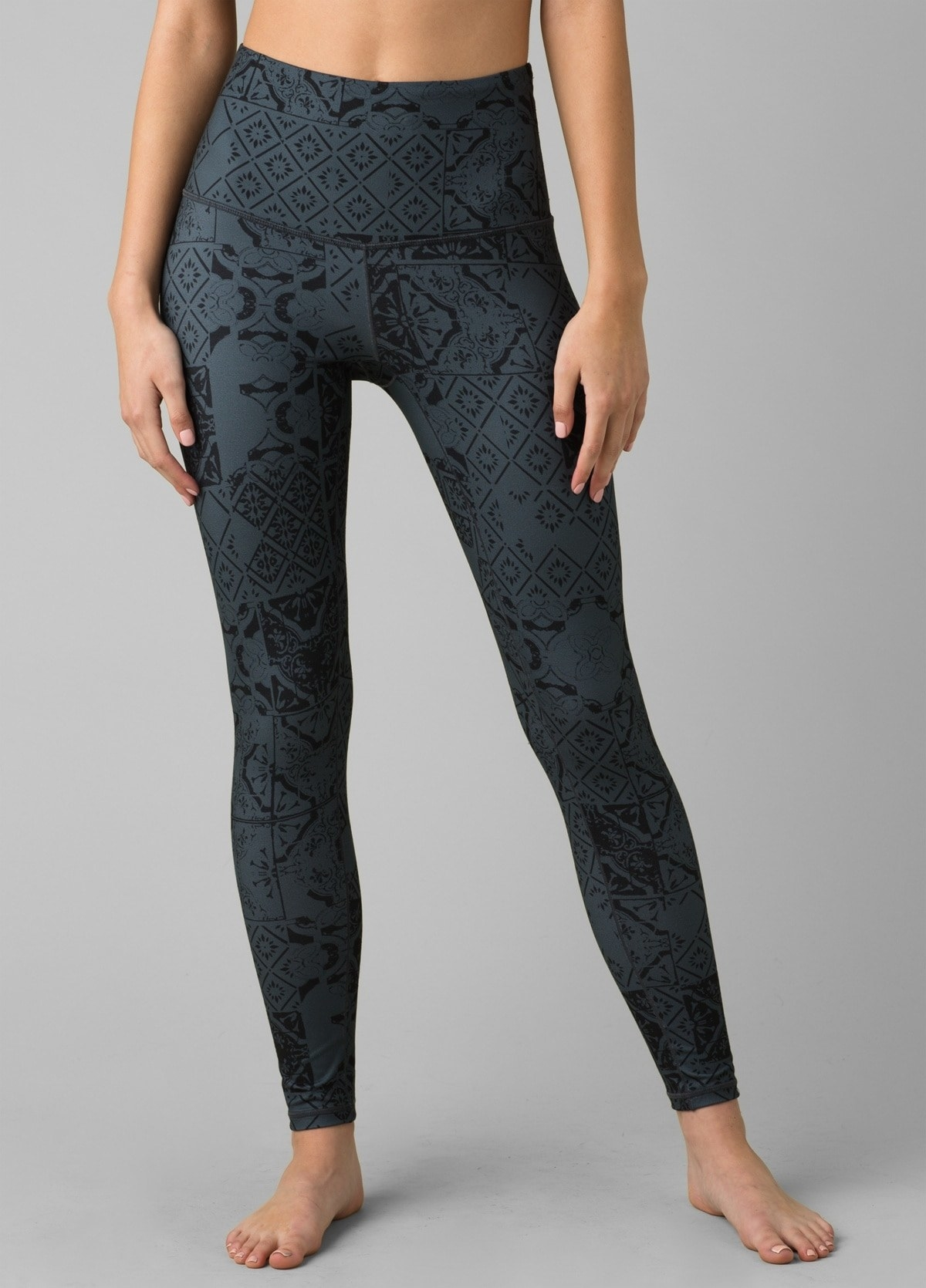 model in grey and black patterned leggings