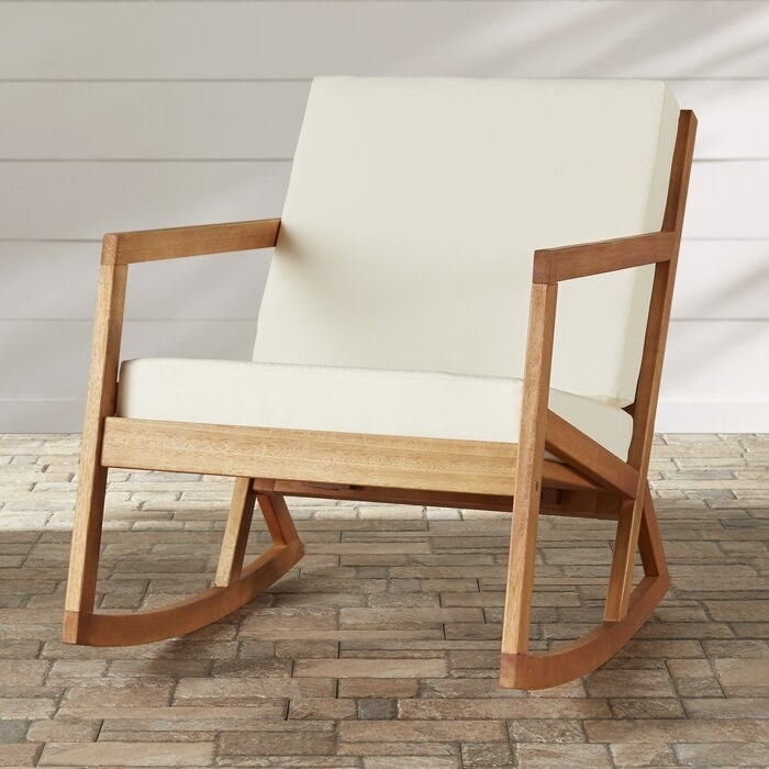 Outdoor rocking chair with cushions in beige fabric