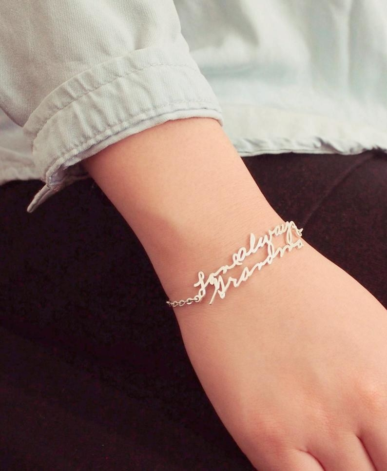 "The silver bracelet with the words ""Love always, Grandma"" in cursive"