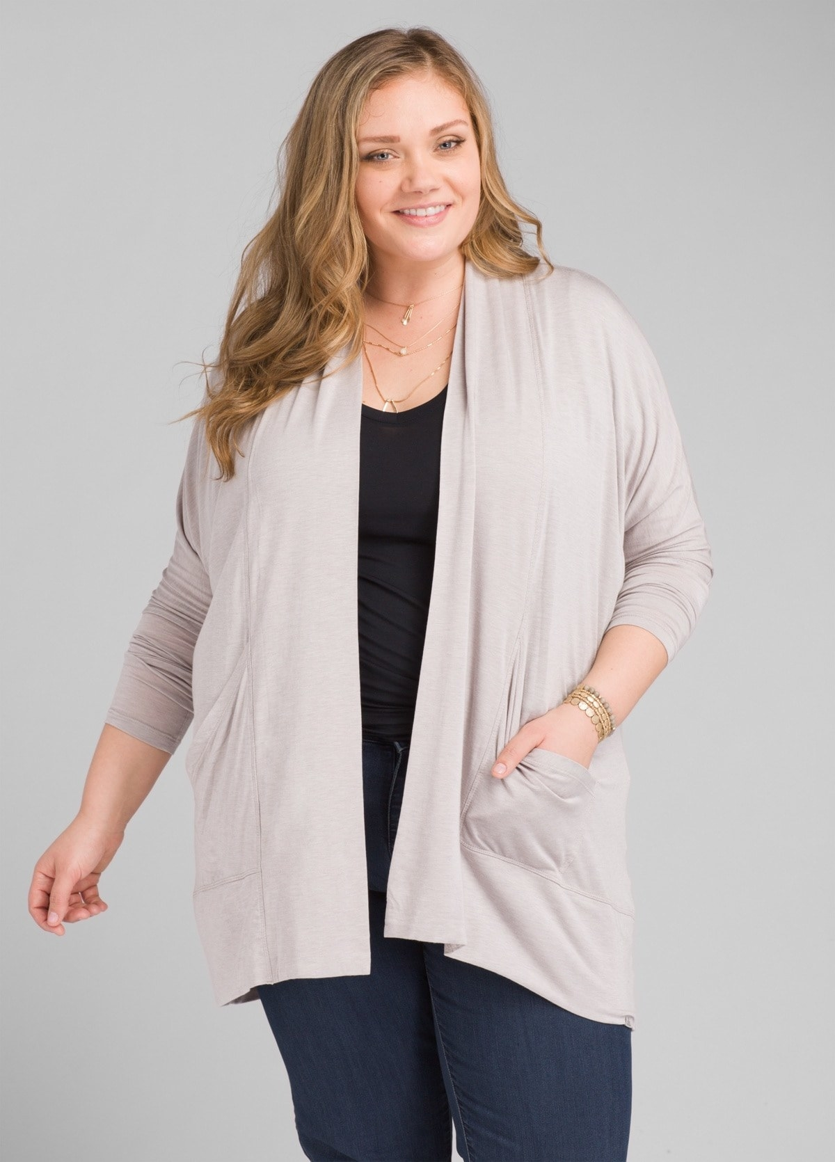 model in light grey wrap with long sleeves and angled front pockets
