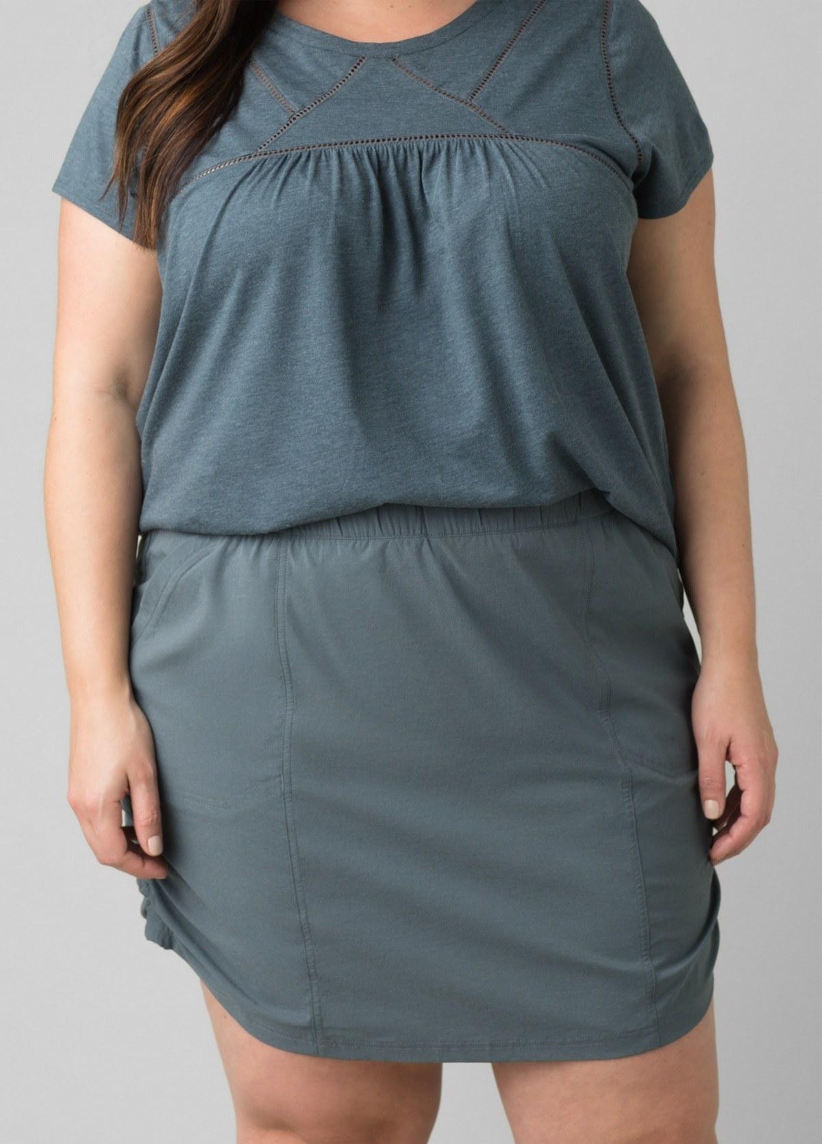model in greyish blue mid-thigh length skort with an elastic waistband