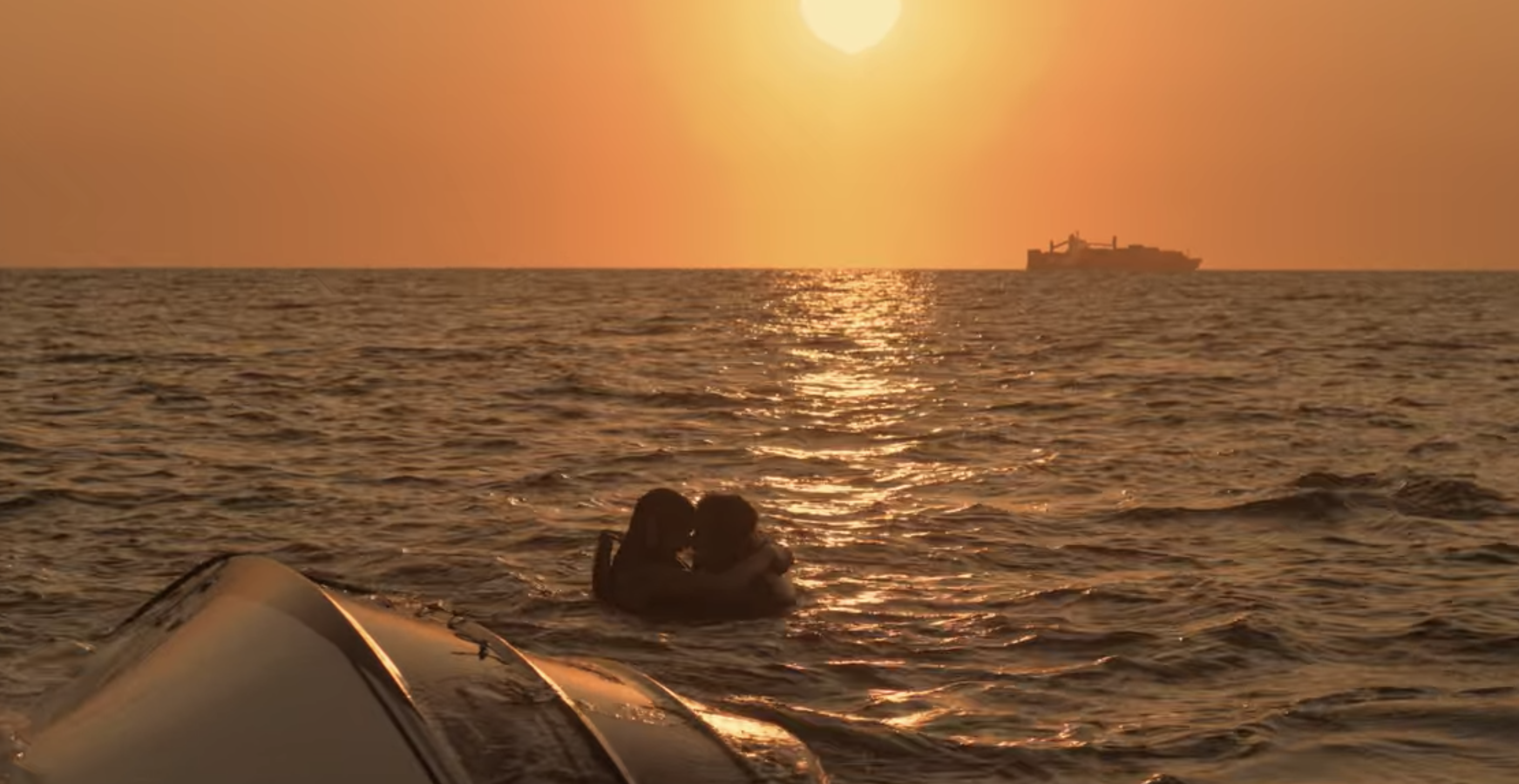 Sarah and John B. hugging in the ocean right before getting rescued