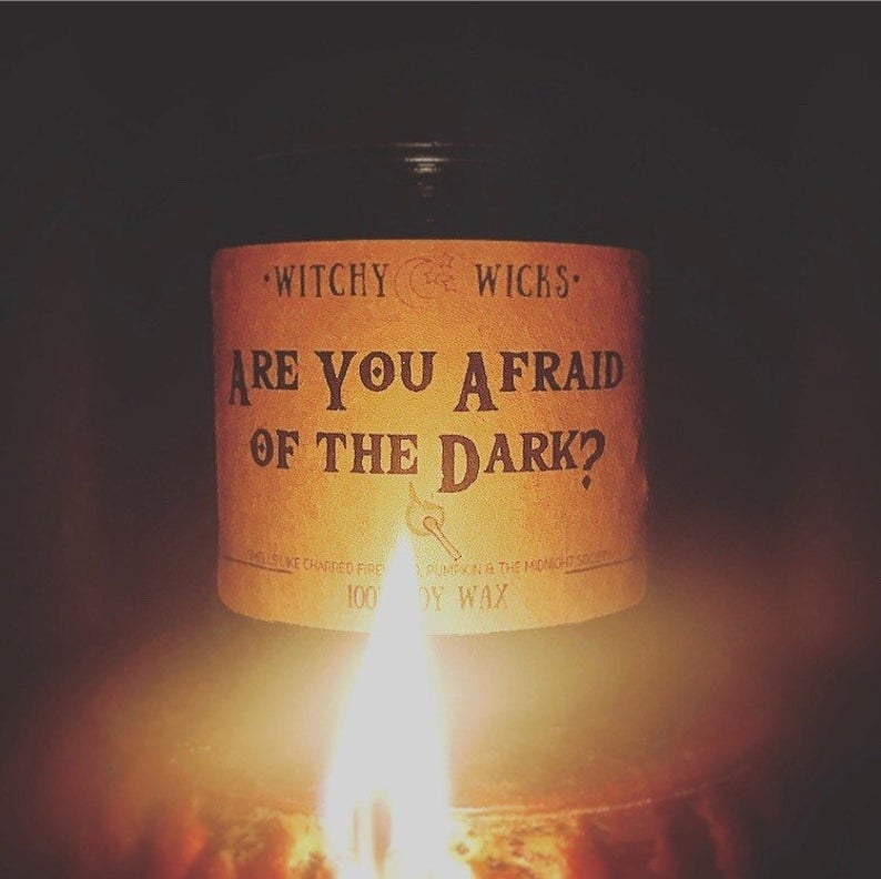 """An """"Are You Afriad Of The Dark?"""" candle."""