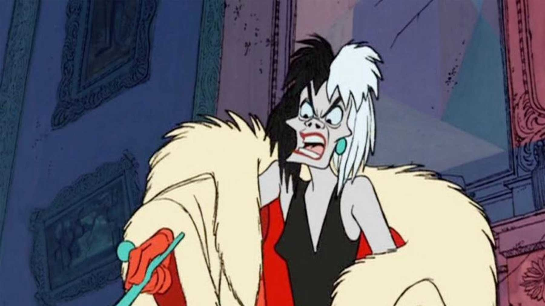 Cruella De Vill, a scrawny woman in a fur coat, points her cigarette holder at something offscreen