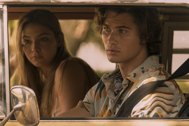 Sarah and John B. driving in the van