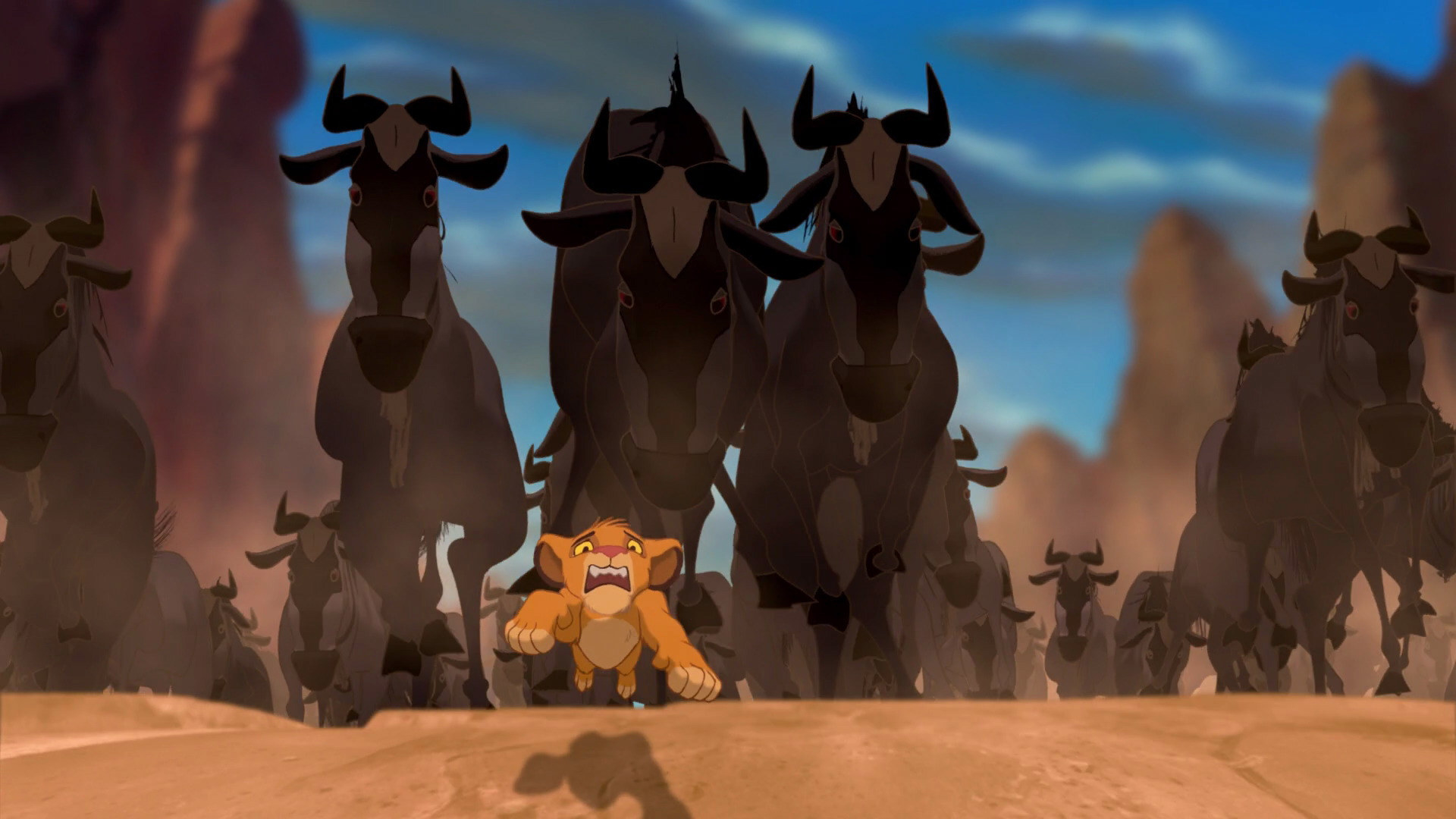Simba runs away from a wildebeest stampede