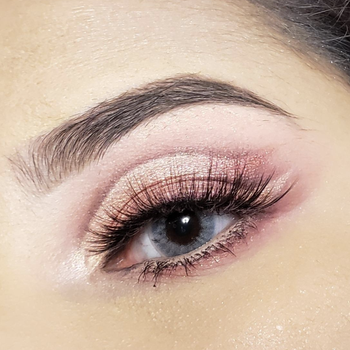 Reviewer using the palette to create a soft pink and sparkly look