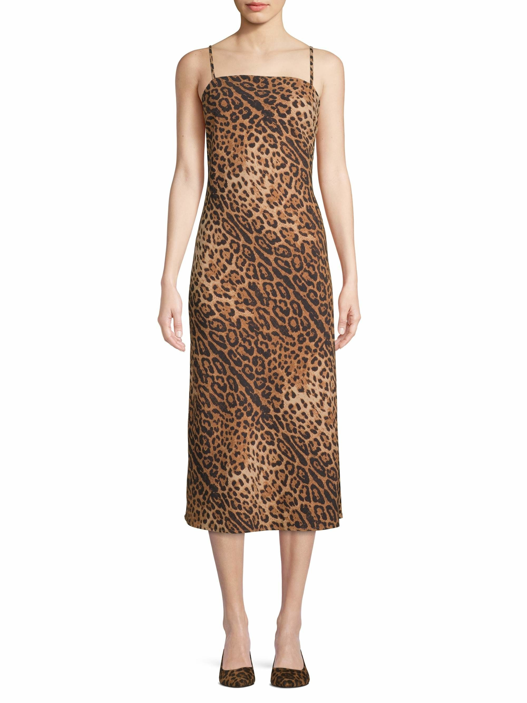 a model in a tan leopard print dress