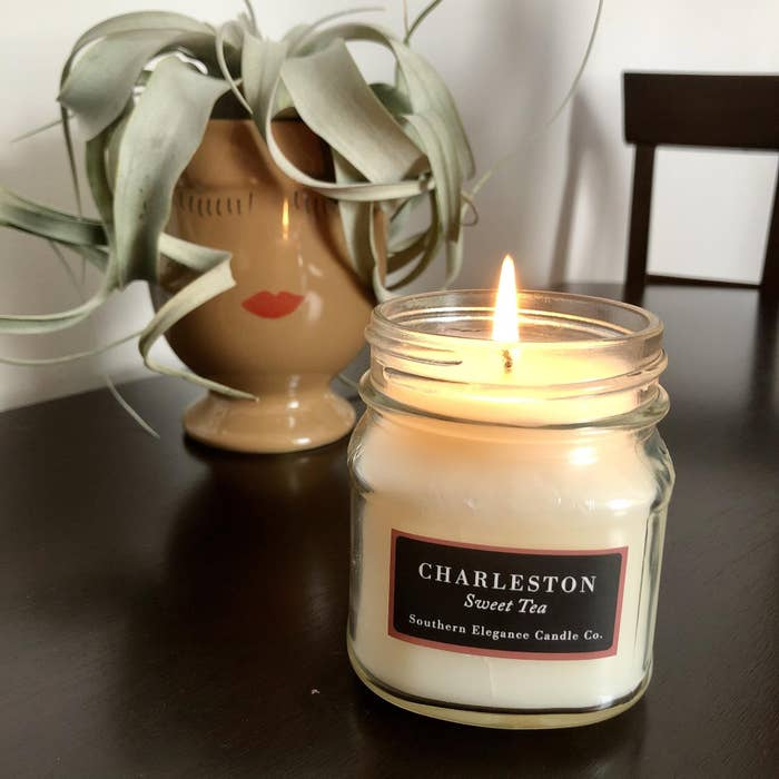 BuzzFeed Shopping editor's picture of the candle on a table