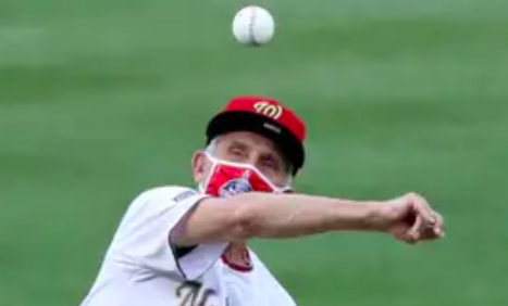 The ball is floating in the air while Fauci looks at it