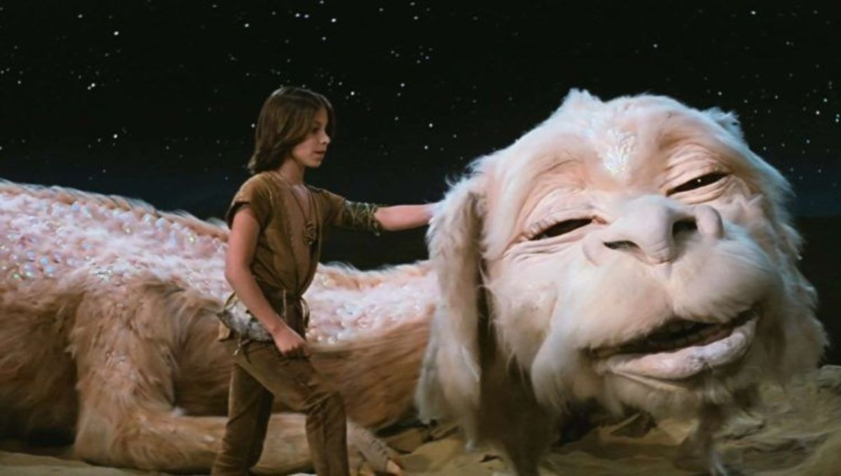 Atreyo, a young boy, pets Falkor, a gigantic Luckdragon