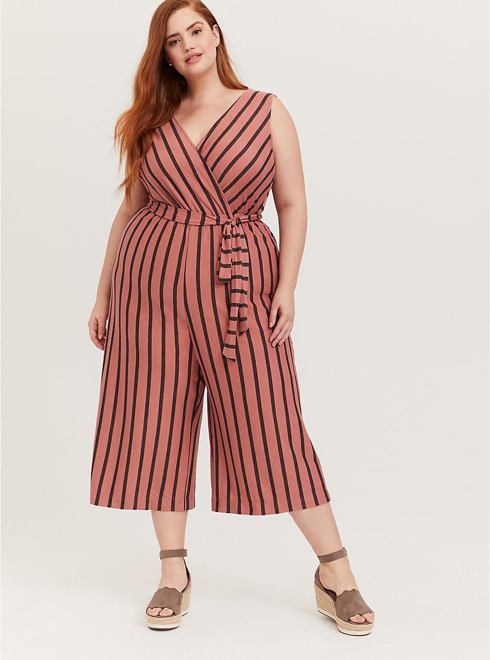 Model wearing the striped self-tie jumpsuit