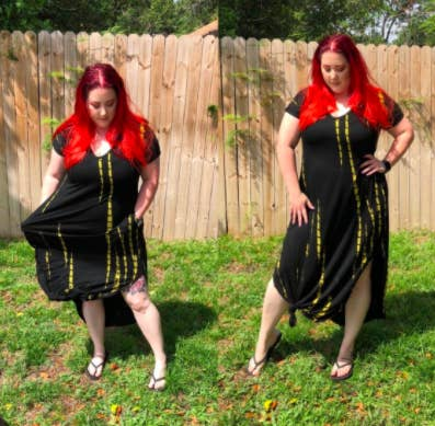 plus size reviewer wearing the black V-neck maxi dress with side slits and knotted in the front so you can see some more leg