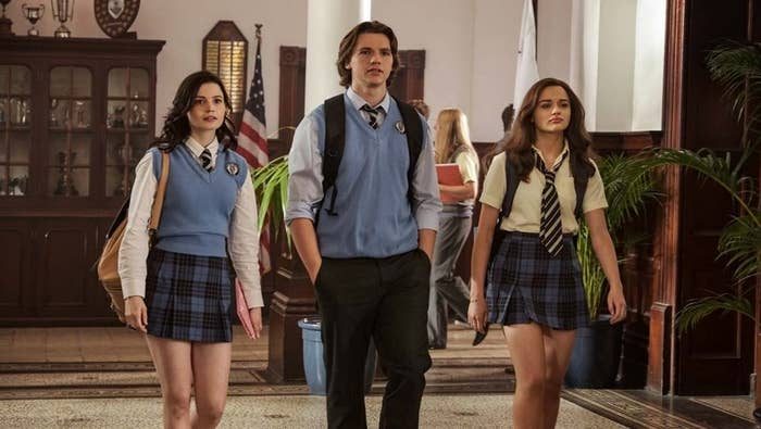 "Rachel, Lee, and Elle walking down the hallway of their school in ""The Kissing Booth 2."""