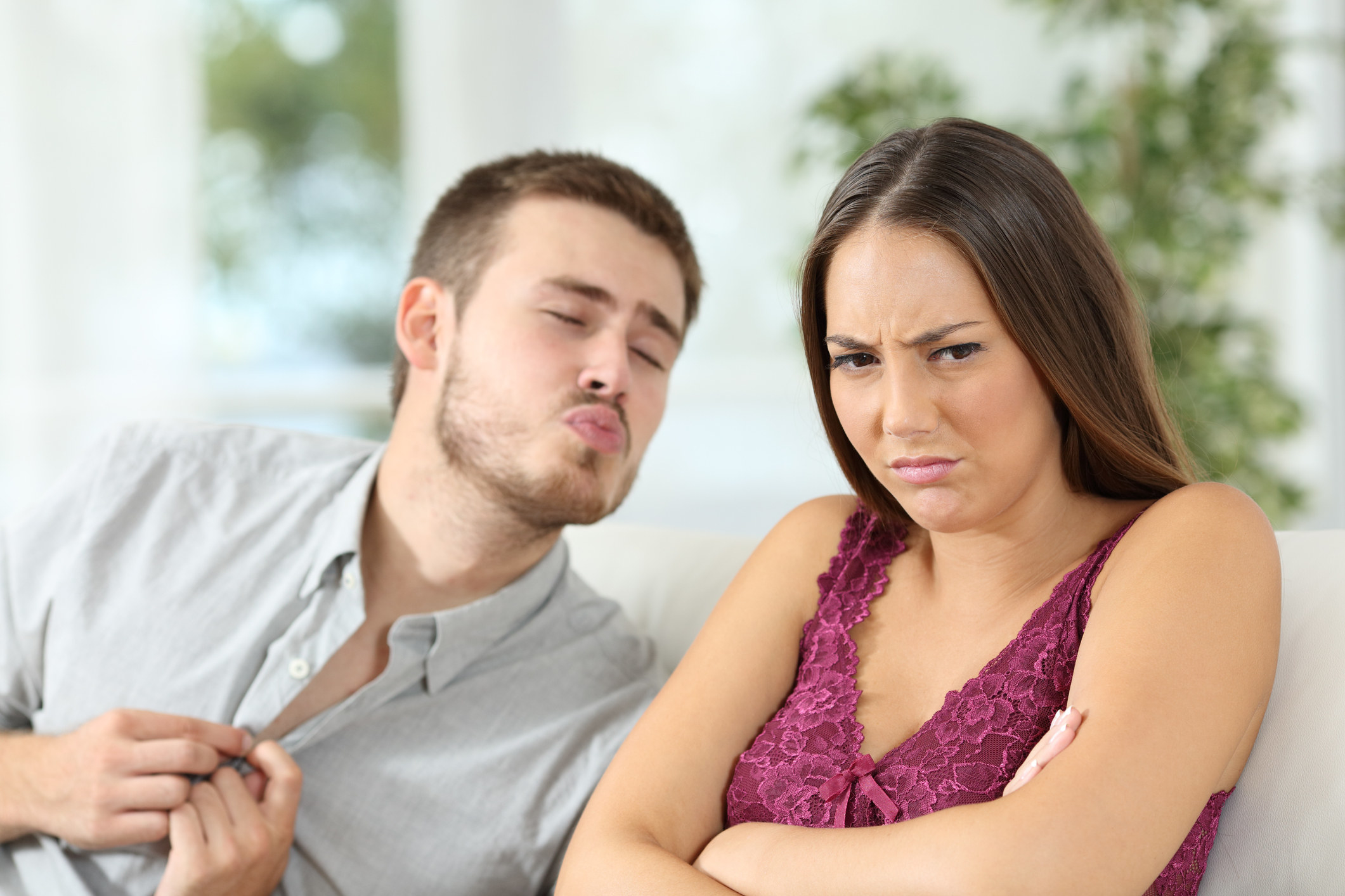 photo of a woman turning away from her brother in anger