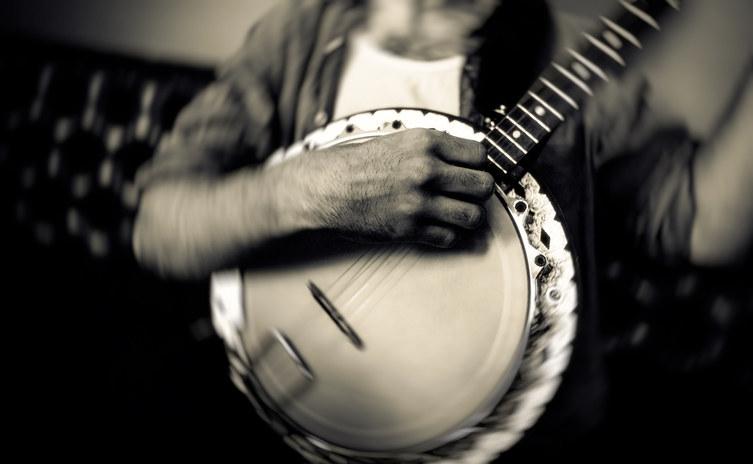 Man playing banjo.