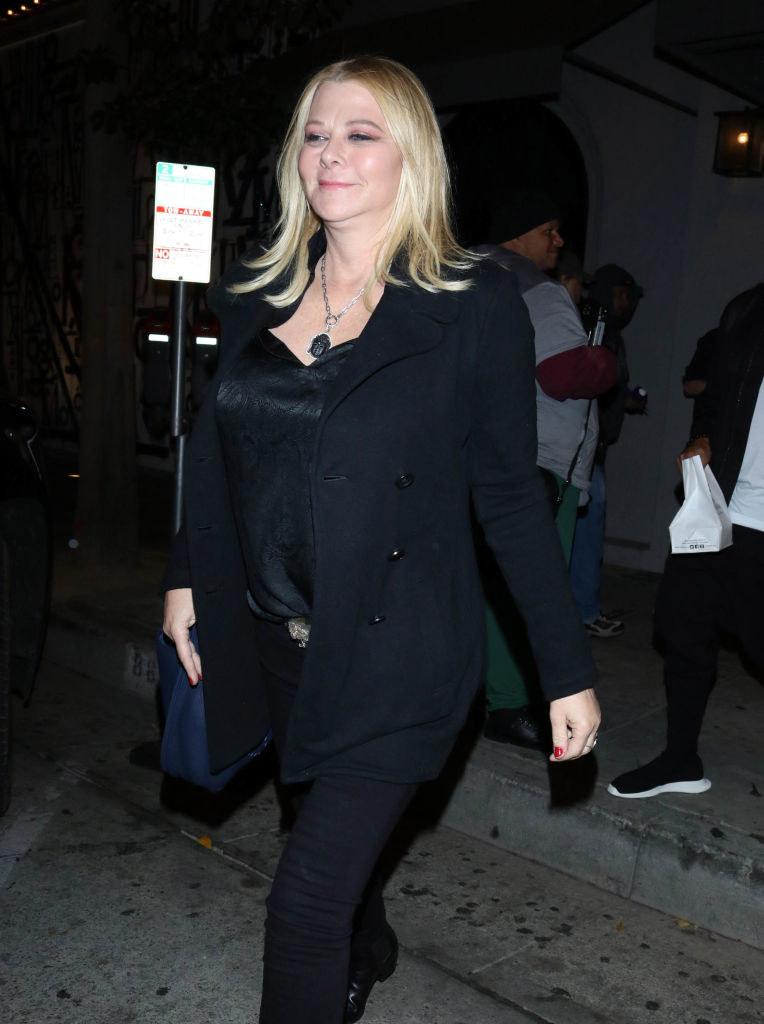 Sheryl walking down a street in 2019