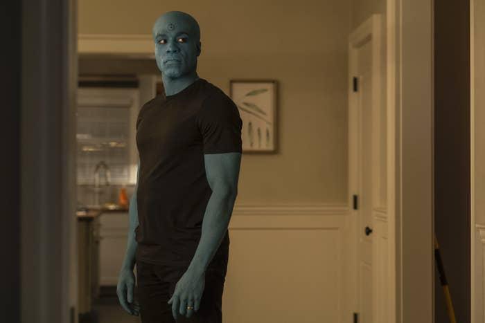 """Yahya with blue skin as Doctor Manhattan in """"Watchmen"""""""