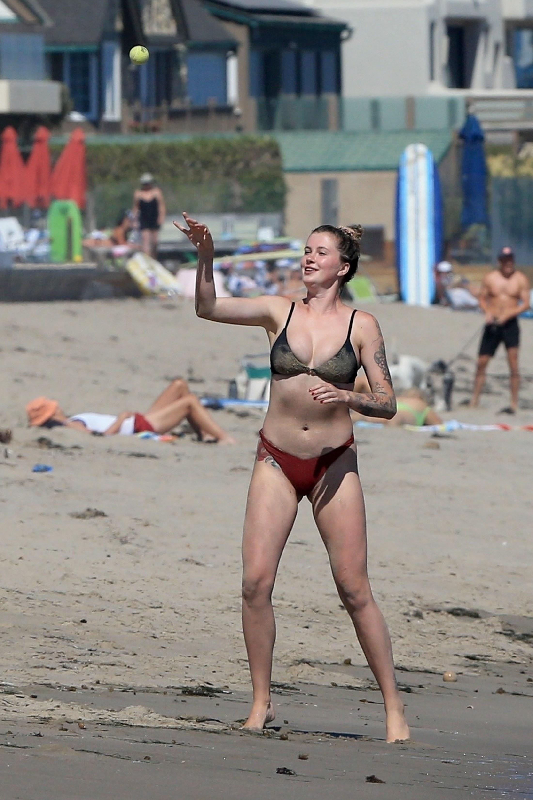 Ireland Baldwin playing volleyball on the beach