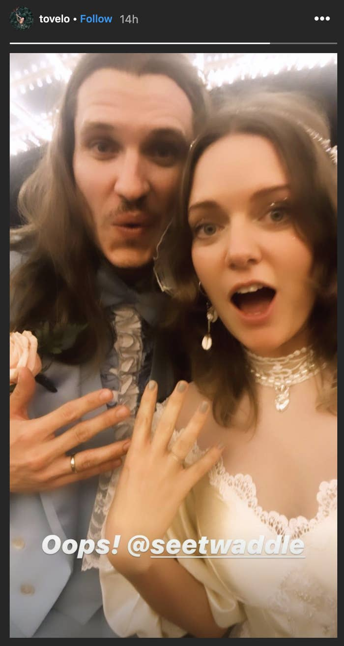 """Tove and Charlie smiling and showing off their wedding bands with the caption """"Oops!"""""""