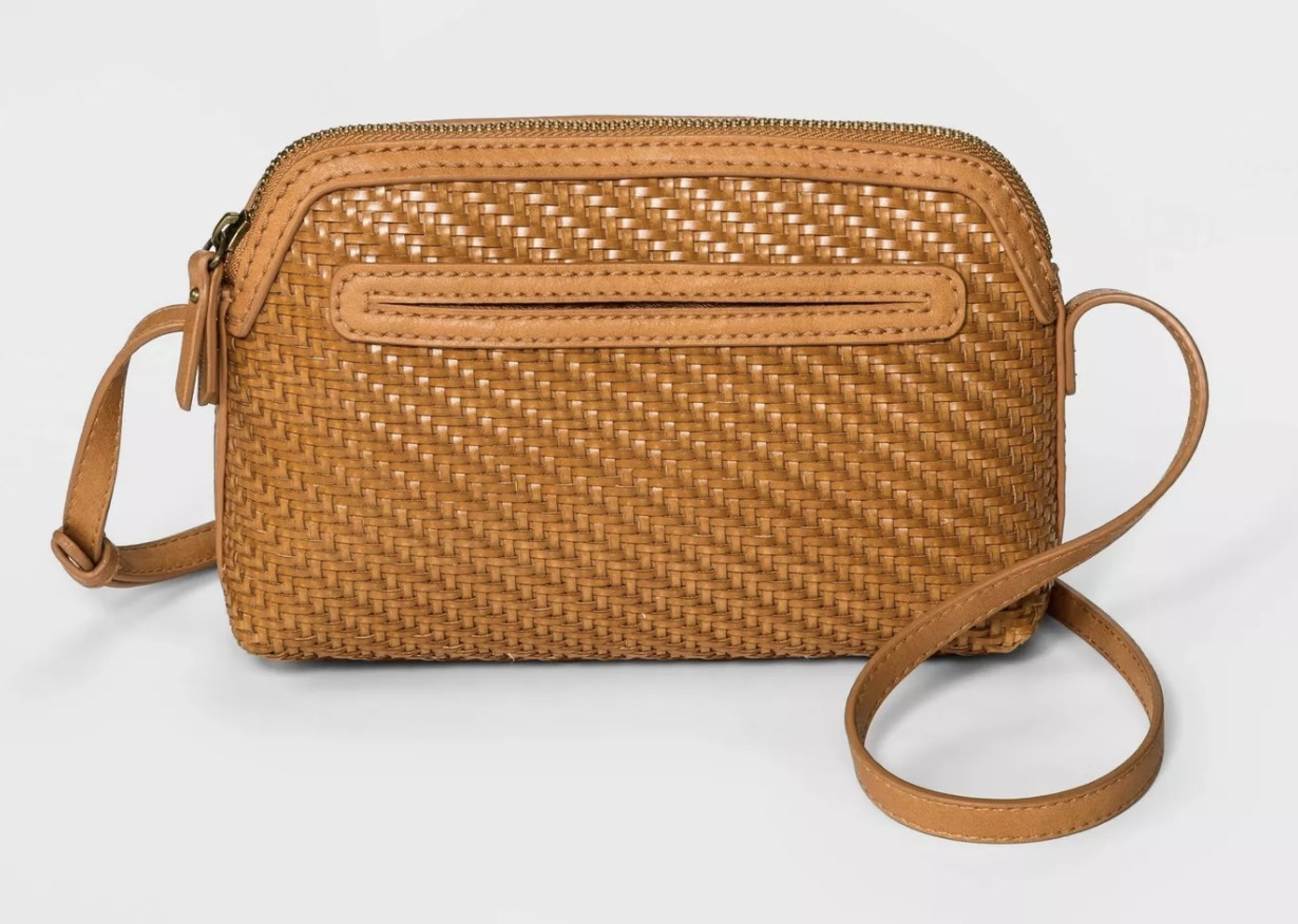 A cognac colored handbag with woven texture