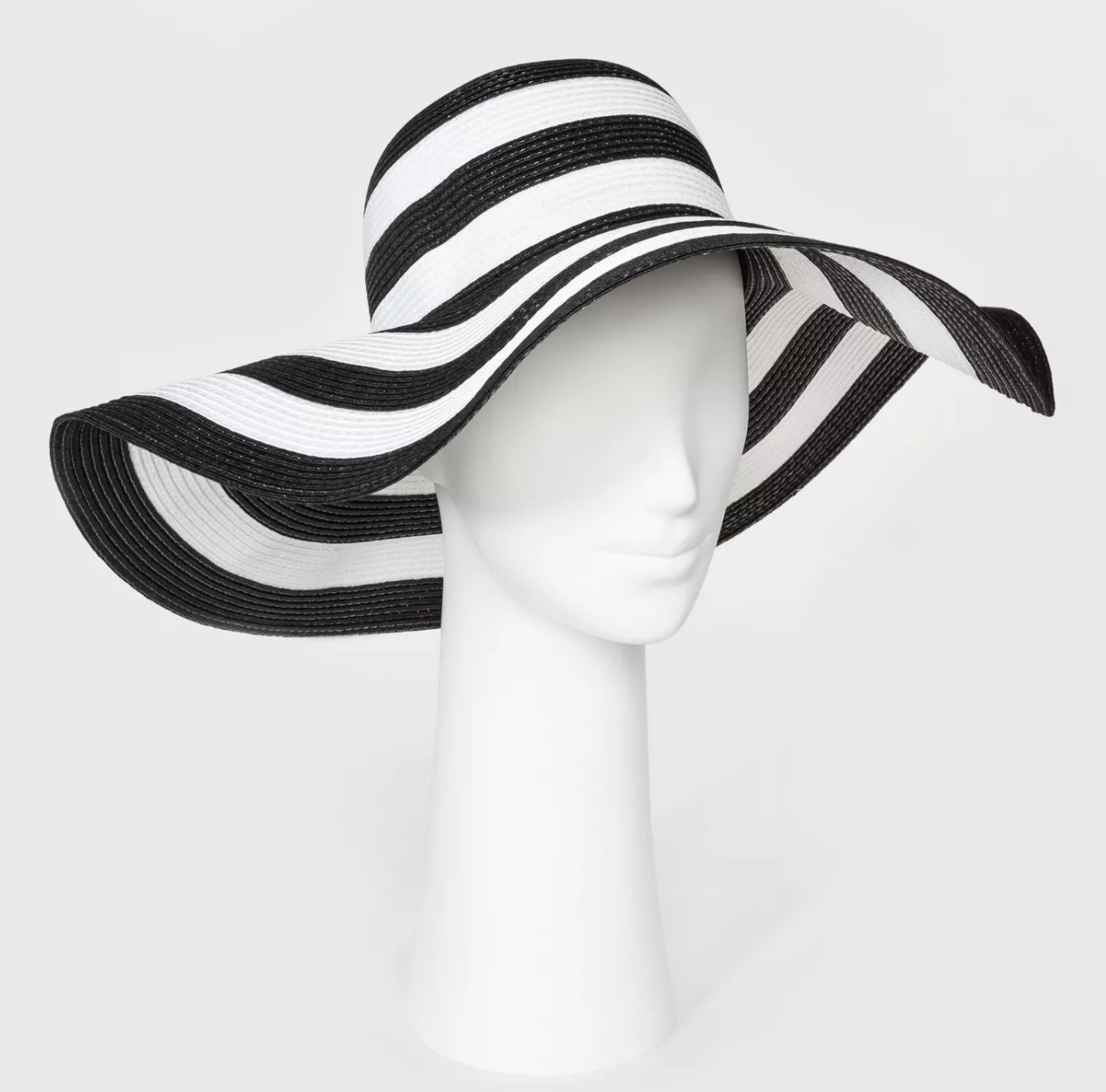 The black and white striped hat with dramatic oversized brim