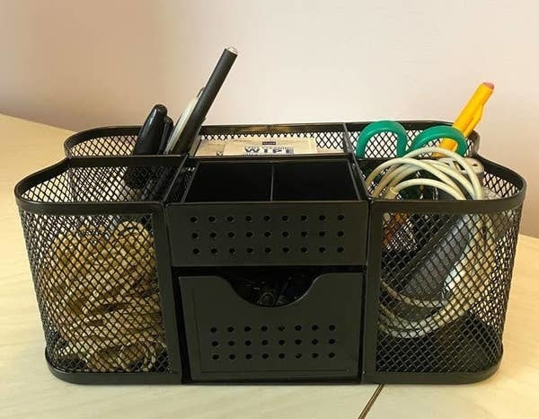 The organizer in black with five basket bins, and two drawers