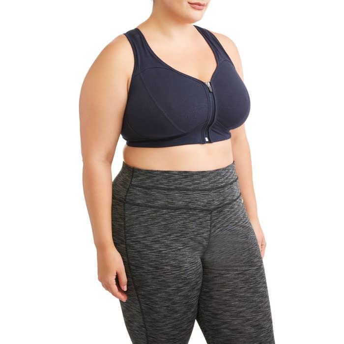 Model wearing the zip-up sports bra
