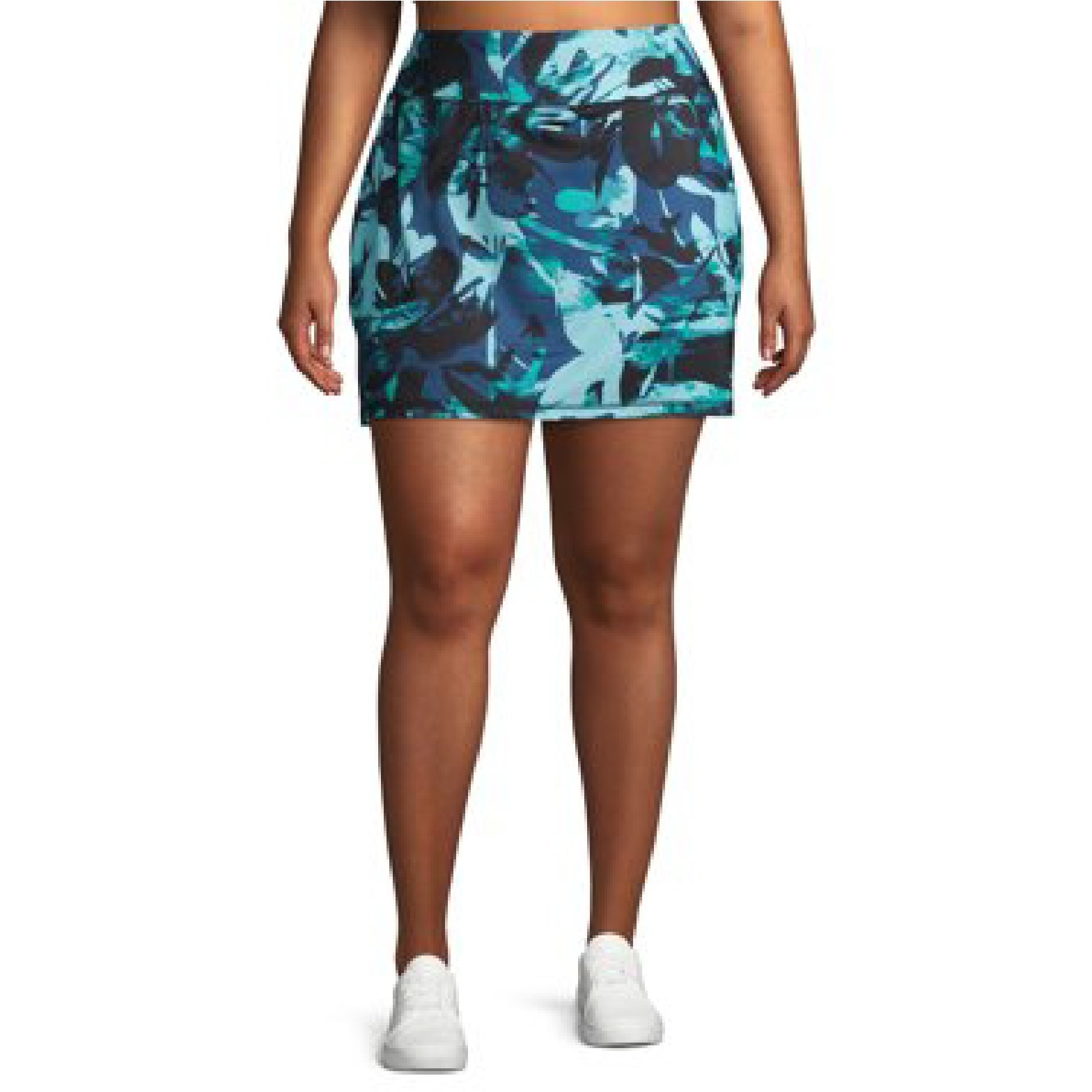 Model wearing the blue skort with tropical leaf pattern