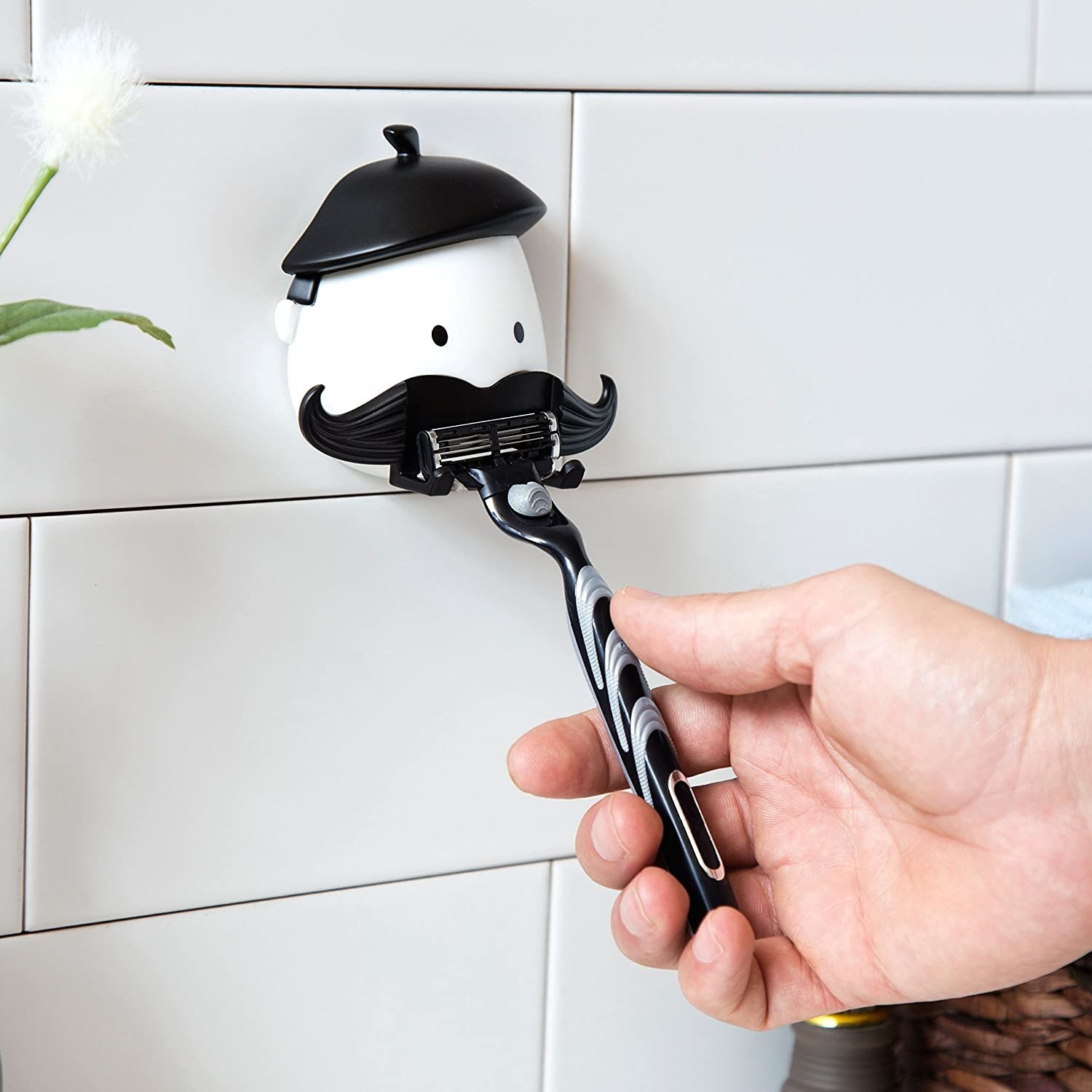 the holder storing a razor in the shower