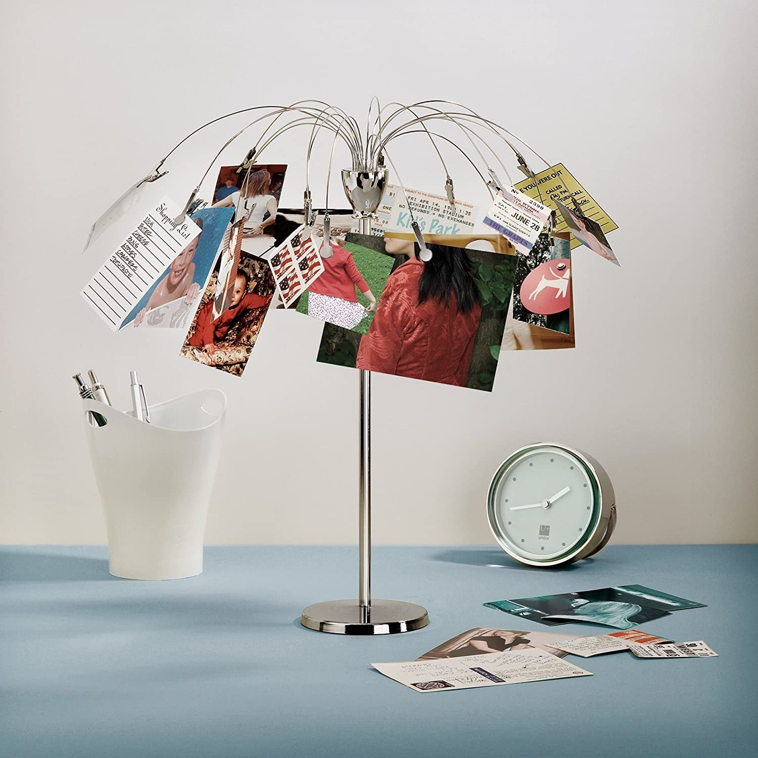 the metal photo tree holding photos and strips of paper