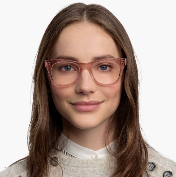 A smiling person wearing the acrylic frames