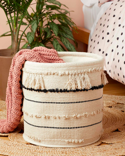 A blanket spilling out of the woven basket