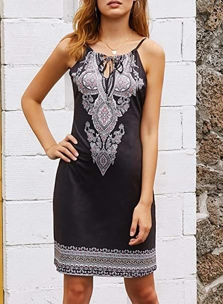 model wearing mini dress with spaghetti straps and boho pattern
