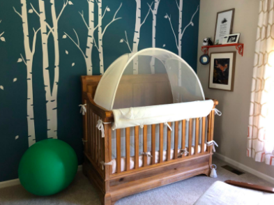 A forest themed nursery with this crib tent tied to the poles on the crib. The entire thing is mesh and breathable and the top is high enough for a child to stand and jump.