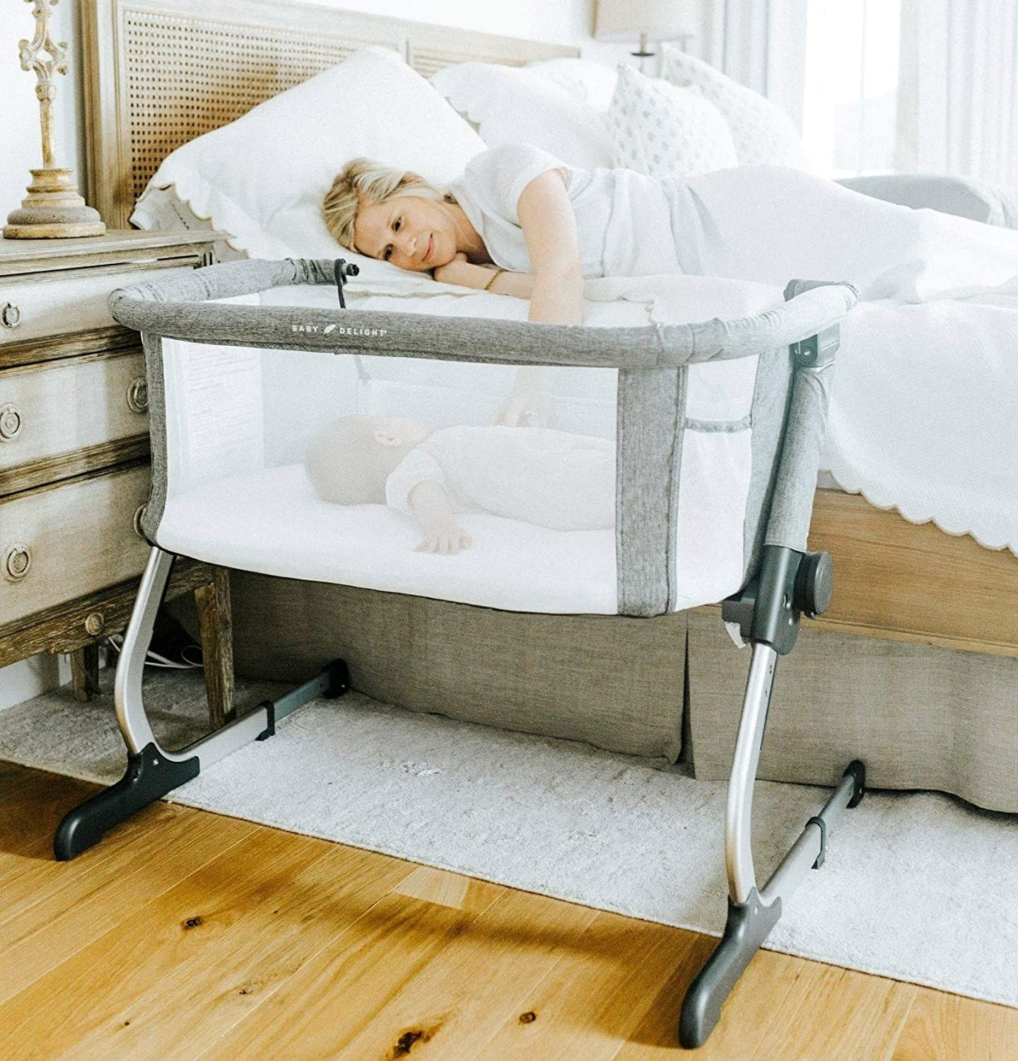 A small bassinet with an open side by the parent's bed, allowing them to reach for their baby